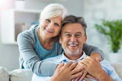 Senior couple embracing. Loving senior couple at home Royalty Free Stock Photos
