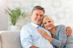 Senior couple embracing. Loving senior couple at home Royalty Free Stock Photography