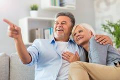 Senior couple embracing. Loving senior couple at home Stock Photo