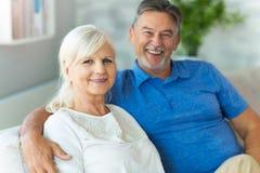 Senior couple embracing. Loving senior couple at home Stock Photography