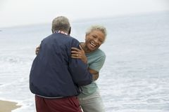 Senior couple embracing by ocean Stock Images