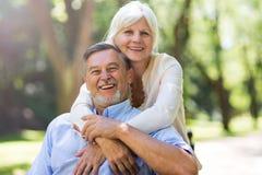 Senior couple embracing outdoors. Loving senior couple embracing outdoors Royalty Free Stock Photography