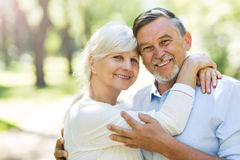 Senior couple embracing outdoors Stock Photo