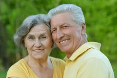 Senior couple embracing outdoors Royalty Free Stock Image