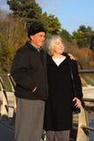 Senior couple enjoy seaside walk. royalty free stock photography