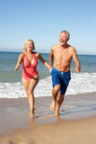 Senior Couple Enjoying Beach Holiday Stock Image