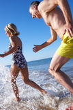 Senior Couple Enjoying Beach Holiday Stock Images