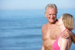 Senior Couple Enjoying Beach Holiday Stock Photography