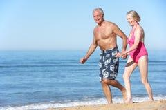 Senior Couple Enjoying Beach Holiday Royalty Free Stock Images