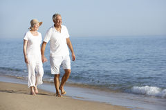 Senior Couple Enjoying Beach Holiday Royalty Free Stock Photos