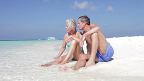 Senior Couple Enjoying Beach Holiday stock footage