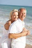 Senior Couple Enjoying Beach Holiday In The Sun Royalty Free Stock Photo