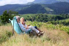Senior couple enjoying beautiful landscape of mountains Royalty Free Stock Photos