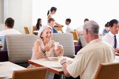 Senior Couple Enjoying Breakfast In Hotel Restaurant Royalty Free Stock Images
