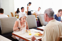 Senior Couple Enjoying Breakfast In Hotel Restaurant Royalty Free Stock Image