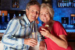 Senior Couple Enjoying Cocktail In Bar Stock Photo