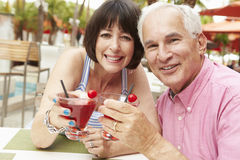 Senior Couple Enjoying Cocktails In Outdoor Bar Together Royalty Free Stock Photo