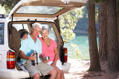 Senior couple enjoying a country picnic. Smiling at camera Stock Photo