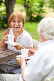 Senior couple enjoying cup of coffee outdoors Stock Photography
