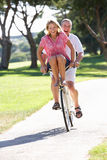 Senior Couple Enjoying Cycle Ride Stock Images