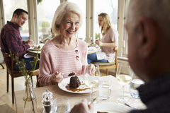 Senior Couple Enjoying Dessert In Restaurant Together Stock Photo
