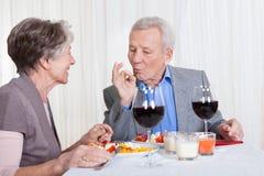 Senior Couple Enjoying Dinner Together Royalty Free Stock Photos