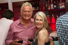 Senior Couple Enjoying Drink In Bar Stock Photos