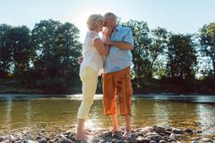 Senior couple enjoying a healthy and active lifestyle outdoors in summer stock photo