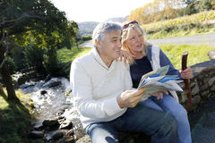 Senior couple enjoying hiking day in nature Royalty Free Stock Photography