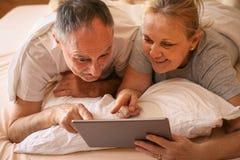 Senior couple enjoying at home. Stock Photos