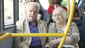 Senior Couple Enjoying Journey On Bus. Senior couple chatting together during bus journey.Shot on Sony FS700 in PAL format at a frame rate of 25fps stock footage