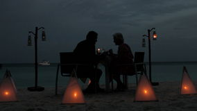 Senior Couple Enjoying Late Meal In Outdoor Restaurant stock video footage