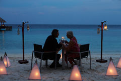 Senior Couple Enjoying Late Meal In Outdoor Restaurant. Together Stock Photo