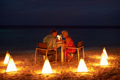 Senior Couple Enjoying Late Meal In Outdoor Restaurant. Together Royalty Free Stock Photos
