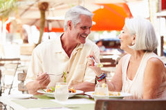 Senior Couple Enjoying Lunch In Outdoor Restaurant Royalty Free Stock Photography