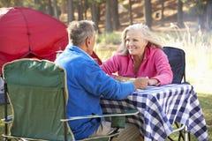 Senior Couple Enjoying Meal On Camping Holiday Royalty Free Stock Images