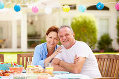 Senior Couple Enjoying Meal In Garden Together Royalty Free Stock Image