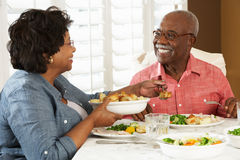 Senior Couple Enjoying Meal At Home Stock Photo