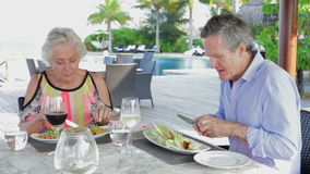 Senior Couple Enjoying Meal In Outdoor Restaurant. Shot on Canon 5d Mk2 with a frame rate of 30fps stock video