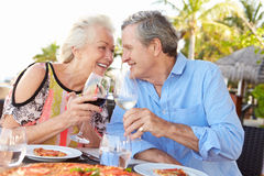 Senior Couple Enjoying Meal In Outdoor Restaurant Royalty Free Stock Photography
