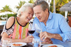 Senior Couple Enjoying Meal In Outdoor Restaurant Royalty Free Stock Images