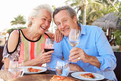 Senior Couple Enjoying Meal In Outdoor Restaurant Royalty Free Stock Photos