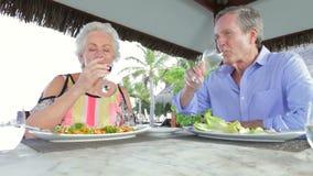 Senior Couple Enjoying Meal In Outdoor Restaurant stock video