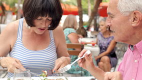 Senior Couple Enjoying Meal In Outdoor Restaurant Together stock video footage