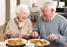 Senior Couple Enjoying Meal Together Royalty Free Stock Photo