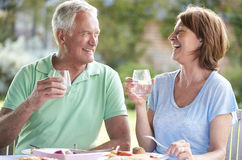 Senior Couple Enjoying Outdoor Meal Together Stock Image