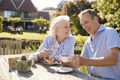 Senior Couple Enjoying Outdoor Summer Snack At Cafe stock photos