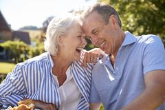 Senior Couple Enjoying Outdoor Summer Snack At Cafe stock images
