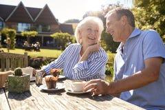 Senior Couple Enjoying Outdoor Summer Snack At Cafe royalty free stock photography