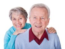 Senior couple enjoying piggyback ride Stock Photos
